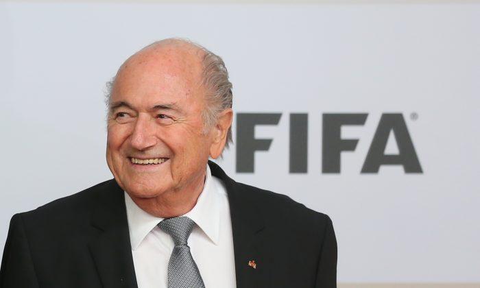 FIFA President Joseph S. Blatter arrives for the movie premiere 'Die Mannschaft' at Sony Center Berlin on Nov. 10, 2014, in Berlin, Germany. (Alexander Hassenstein/Bongarts/Getty Images)