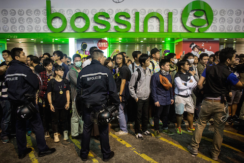 Pro-democracy protesters and pedestrians are stopped from entering a street by police in Mong Kok on November 26, 2014 in Hong Kong. (Chris McGrath/Getty Images)