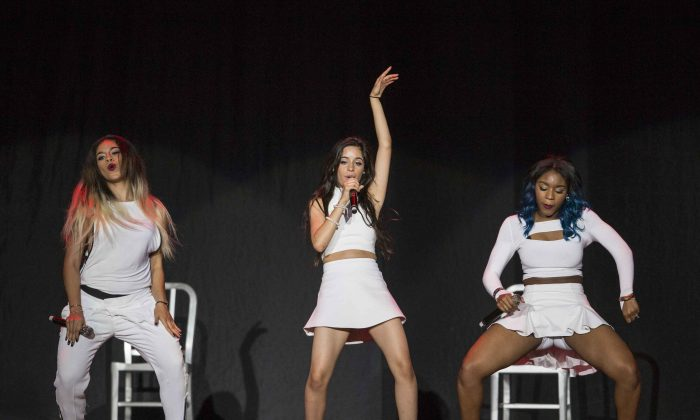Ally Brooke, Camila Cabello and Normani Hamilton as Fifth Harmony performs during the Austin Mahone Live on Tour at Verizon Wireless Amphitheatre at Encore Park on Sunday, Sep. 7, 2014, in Atlanta. (Photo by Katie Darby/Invision/AP)