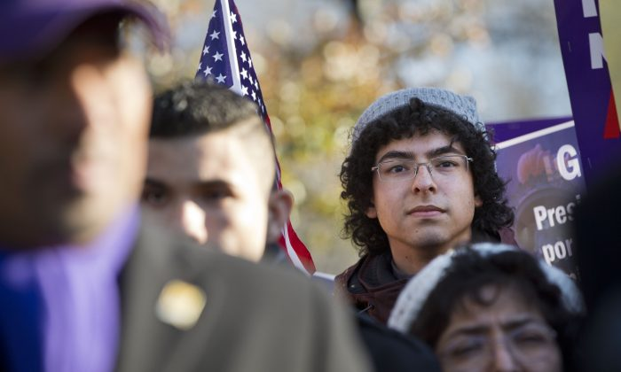 "Daniel Nino, 20, who is originally from Colombia and qualified for the the DACA program, attends a rally in front of the White House in Washington, Friday, Nov. 21, 2014, with other supporters of immigration reform thanking President Obama for his executive action on illegal immigration. ""My parents are not eligible under the executive action,"" says Nino, ""I hope that Congress gets the guts to pass a comprehensive bill."" (AP Photo/Jacquelyn Martin)"