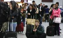 Sloppy Weather Slows Thanksgiving Travelers