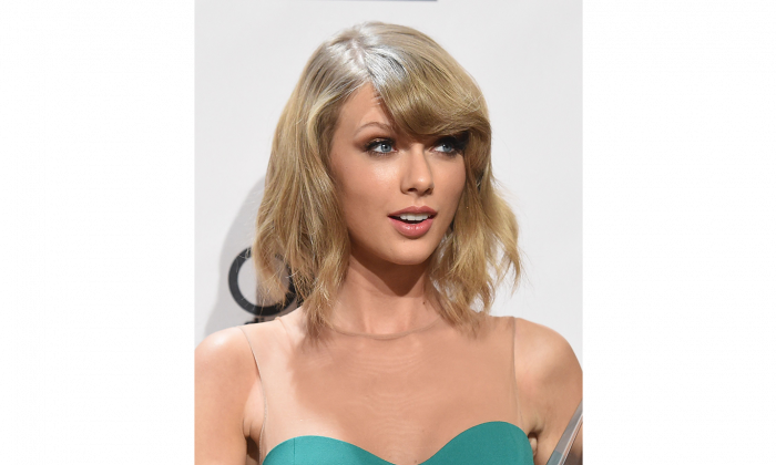 Singer/songwriter Taylor Swift poses in the press room at the 2014 American Music Awards at the Nokia Theatre in Los Angeles on Nov. 23, 2014. Swift says musicians are under-compensated by Spotify. (Jason Merritt/Getty Images)