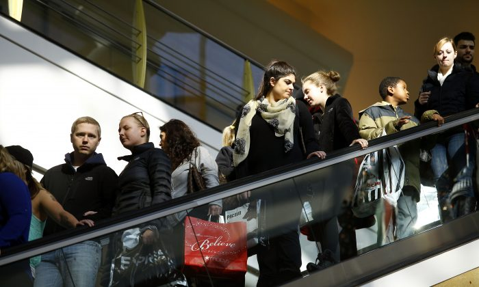 Shoppers ride an escalator as they shop for Black Friday deals at Somerset Collection shopping mall on Nov. 29, 2013, in Troy, Michigan. (Joshua Lott/Getty Images)