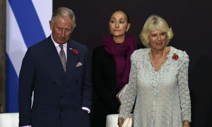 Prince Charles of Wales (L) and his wife Camilla (R), Duchess of Cornwall, pose after a speech at the National Palace during a meeting with Mexican President Enrique Pena Nieto (out of frame), in Mexico City, on November 3, 2014. (AFP/Getty Images)