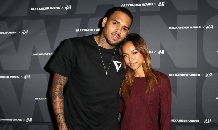 Recording artist Chris Brown (L) and model Karrueche Tran attend the Alexander Wang x H&M Pre-Shop Party at H&M on November 5, 2014 in West Hollywood, California. (Photo by Imeh Akpanudosen/Getty Images for H&M)