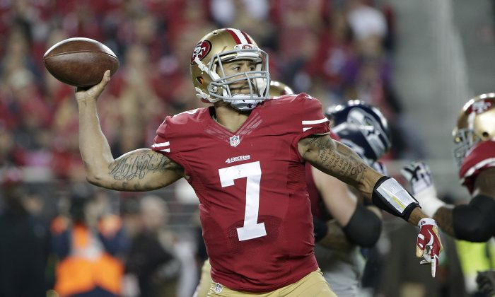 San Francisco 49ers quarterback Colin Kaepernick (7) passes against the Seattle Seahawks during the first quarter of an NFL football game in Santa Clara, Calif., Thursday, Nov. 27, 2014. (AP Photo/Marcio Jose Sanchez)