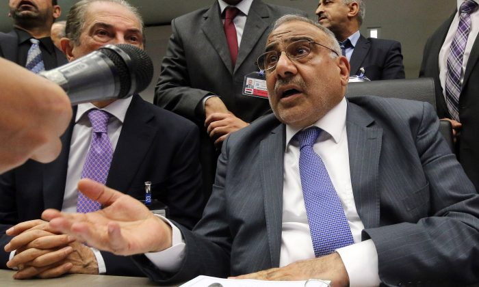 Iraq's Minister of Oil Adil Abd Al-Mahdi speaks to journalists prior to the start of a meeting of the Organization of the Petroleum Exporting Countries, OPEC, at their headquarters in Vienna, Austria, Thursday, Nov. 27, 2014. Expectations that the group would not cut output to support the market saw the global price of oil slump another US dollar 1.89 on Thursday to US dollar 75.86 a barrel, extending its losses since June, when it was as high as US dollar 115. (AP Photo/Ronald Zak)