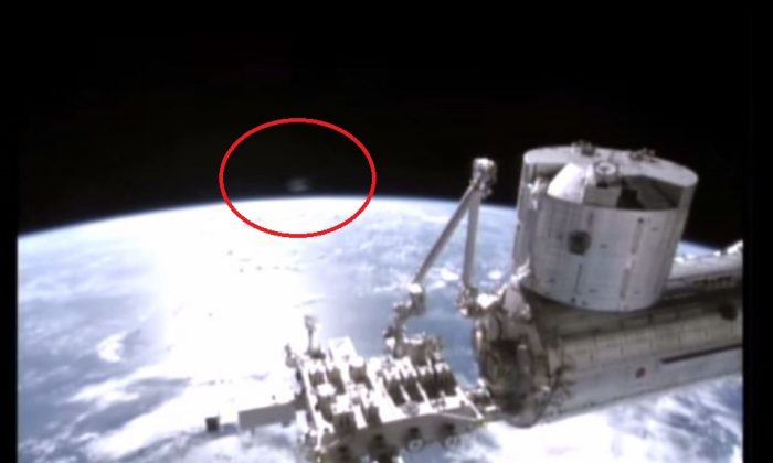 "The red circle (added in) shows a ""UFO"" over the ISS, captured by NASA this month. (NASA stream)"