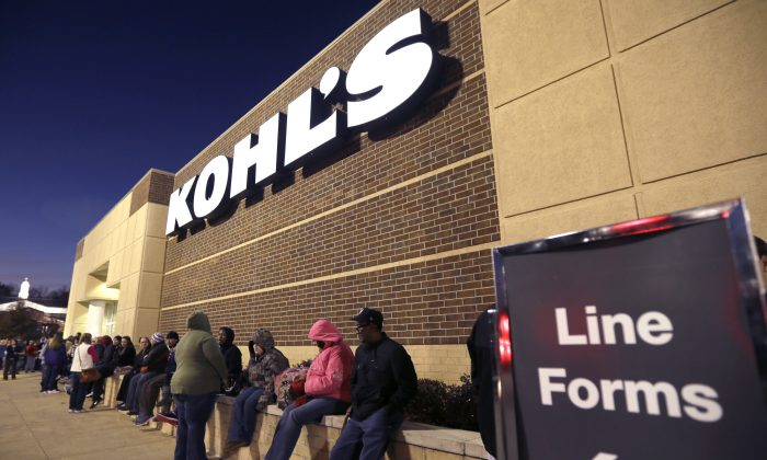 "An article that claims Black Friday, the day after Thanksgiving, started with the ""sale of slaves"" is fake. A line of Thanksgiving shoppers forms at the entrance to a Kohl's department store in Sherwood, Ark., Thursday, Nov. 27, 2014. Early-bird shoppers headed to stores around the nation on Thanksgiving in what's becoming a new holiday tradition. (AP Photo/Danny Johnston)"