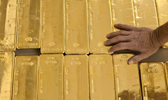 Stacked gold bars at the Cantonal Bank of Zurich ZKB in Zurich, Switzerland, on Aug. 8, 2011. (AP Photo/Keystone, Martin Ruetschi)