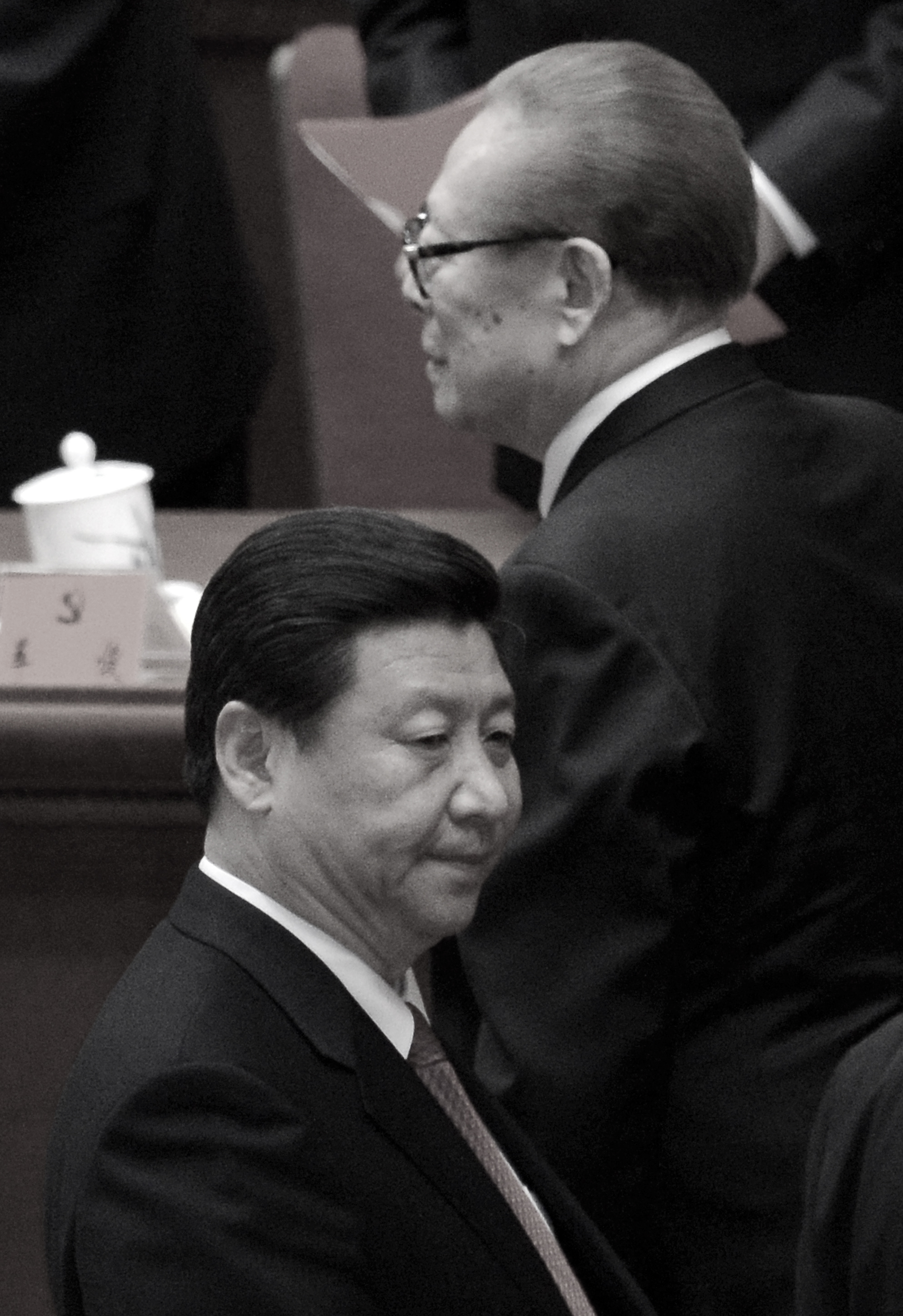 Former Chinese Communist Party head Jiang Zemin (R) walks by Xi Jinping (L) after the closing of the 18th Communist Party Congress at the Great Hall of the People in Beijing on Nov. 14, 2012. At this Party Congress Xi was formally appointed to head the CCP. (Wang Zhao/AFP/Getty Images)