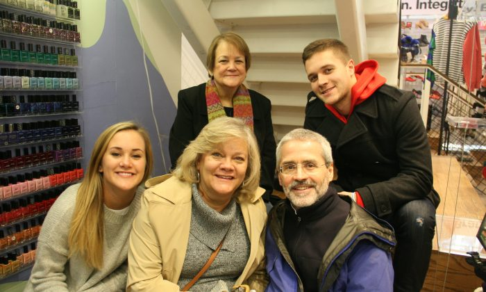 Clockwise from top left: Maureen Shields, Robert Dewald, Tommy Dewald, Mary Dewald, and Katie Dewald at an American Apparel store in Manhattan, New York, N.Y. on Nov. 28, 2014.  (Shannon Liao/Epoch Times)