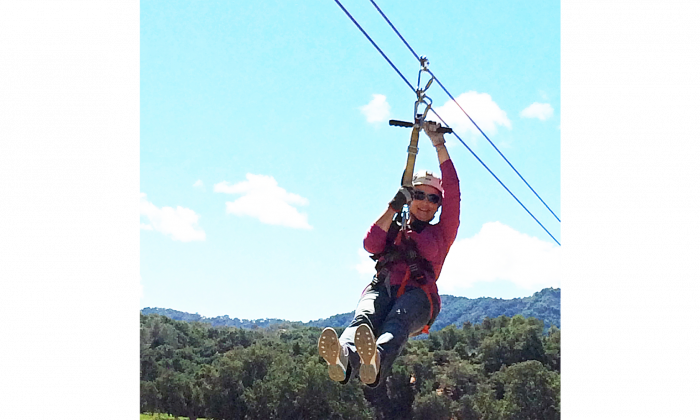 Writer Beverly Mann ziplining on Santa Margarita Ranch overlooking the vineyards of Paso Robles Wine Country. (Courtesy of Margarita Adventures)