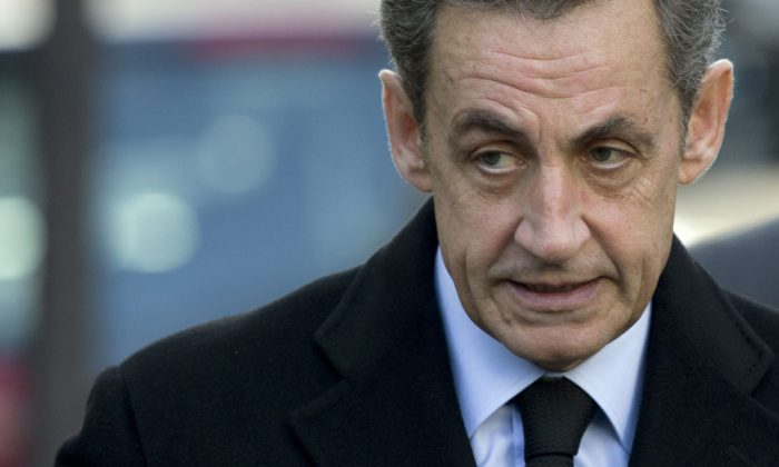Former French president and candidate for the presidency of French right-wing main opposition party UMP Nicolas Sarkozy arrives to vote for the first round of the election, on Nov. 29, 2014, in Paris. (Kenzo Tribouillard/AFP/Getty Images)
