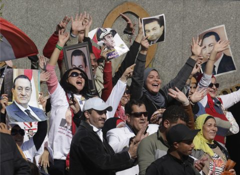 Supporters of former Egyptian President Hosni Mubarak greet him as his helicopter ambulance landed at Maadi Military Hospital, following his verdict in Cairo, Egypt, Saturday, Nov. 29, 2014. An Egyptian court on Saturday dismissed criminal charges against former president Hosni Mubarak in connection with the killing of protesters in the 2011 uprising that ended his nearly three-decade reign. (AP Photo/Amr Nabil)