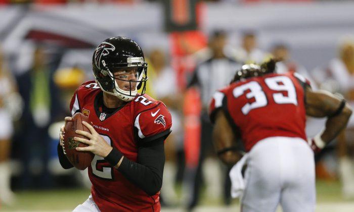 Atlanta Falcons quarterback Matt Ryan (2) works against the Arizona Cardinals during the second half of an NFL football game, Sunday, Nov. 30, 2014, in Atlanta. (AP Photo/John Bazemore)