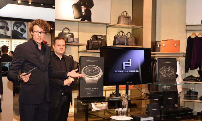 Marc Platten, COO Porsche Design (L), and Karsten Fried, Regional Manager, explain details of two new limited edition, Swiss made, chronograph models to potential customers at the watch launch at Porsche Design's flagship boutique, 30 Queen's Road, Central Hong Kong Nov. 19, 2014. (Bill Cox/Epoch Times)