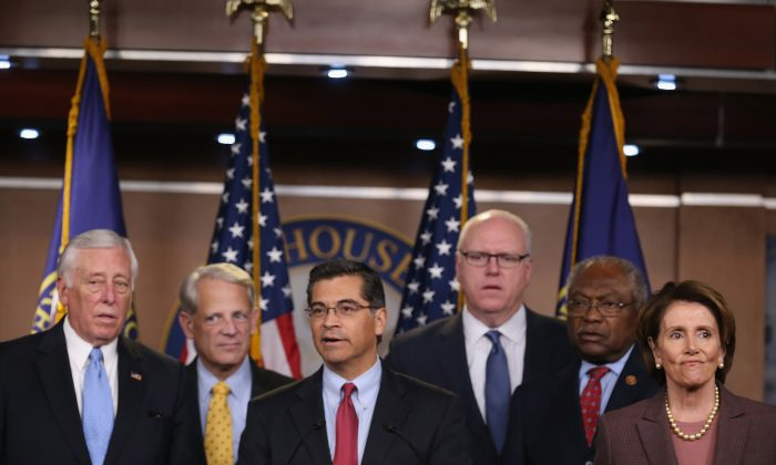 U.S. Rep. Xavier Becerra (D-Calif.) (C) speaks at a news conference, with (L-R) Democratic Whip Steny Hoyer (D-MD.) and representatives Steve Israel (D-N.Y.), Joe Crowley (D-N.Y.), James Clyburn (D-S.C.) and Minority Leader Nancy Pelosi (D-Calif.) in Washington, D.C., on Nov. 18, 2014. Pelosi introduced the Democratic leadership team for the 114th Congress and was re-elected to another two-year term as House minority leader. (Mark Wilson/Getty Images)