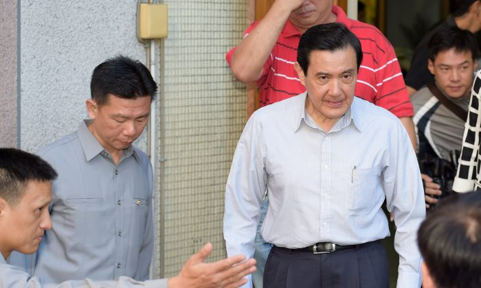 Taiwan President Ma Ying-jeou (2nd R leaves a polling station after voting in Taipei on Nov. 29, 2014. Unease about his pro-China policies contributed to the KMT's crushing electoral defeat in local races across the country (Sam Yeh/AFP/Getty Images)