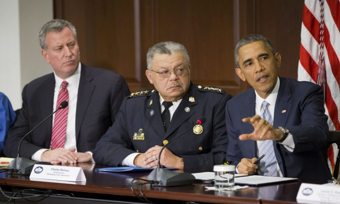 President Barack Obama during a meeting with elected officials, law enforcement officials, and community and faith leaders at the White House on Monday. Among those attending were New York Mayor Bill de Blasio (L) and Charles Ramsey (C), commissioner of the Philadelphia Police Department.  (AP Photo/Pablo Martinez Monsivais)