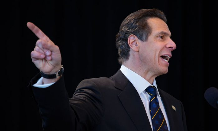 New York Gov. Andrew Cuomo speaks during an inaugural address at One World Trade Center in New York, Thursday, Jan. 1, 2015. (AP Photo/Craig Ruttle)