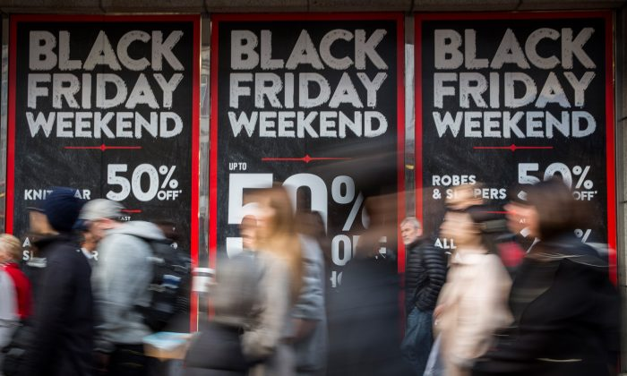 People walk past a shopfront on Oxford Street advertising 'Black Friday' discounts in London, England, on Nov. 28, 2014. (Rob Stothard/Getty Images)