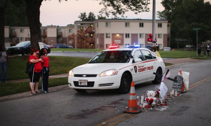 A memorial in the street where 18-year-old Michael Brown was shot by police in Ferguson, Mo., on Aug. 9, 2014. Photo was taken on Aug. 11, 2014. (Scott Olson/Getty Images)