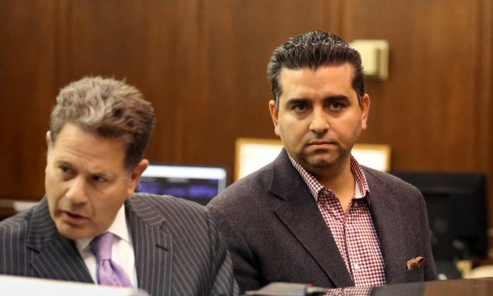 """Cake Boss"" star Buddy Valastro (R) appears at his arraignment on drunk driving charges in Manhattan Criminal Court in New York on Nov. 13, 2014. Valastro on Monday, Dec. 1, 2014, pleaded guilty to driving while ability impaired. His driver's license will be suspended for three months. (AP Photo/New York Daily News, Jefferson Siegel)"
