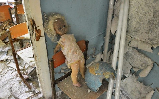 A doll in one of the classrooms in a school in Pripyat (Tomasz Lisowski, www.adventurous-travels.com)