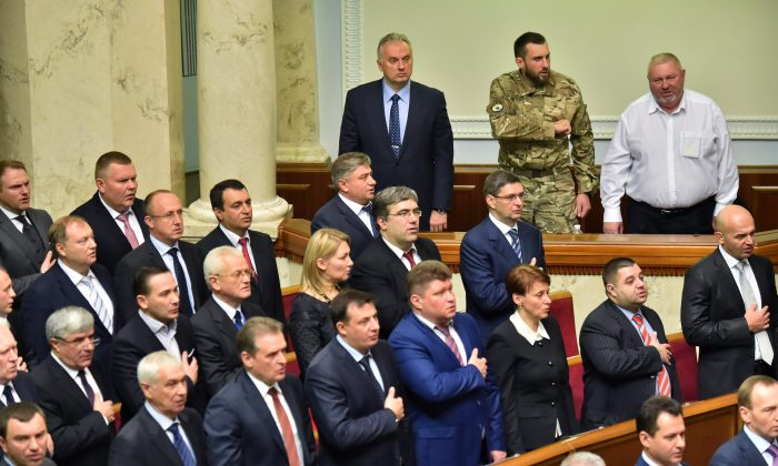 Deputies of the new Ukrainian parliament take the oath of office during the opening of a session in Kiev on Nov. 27, 2014. (Sergei Supinsky/AFP/Getty Images)