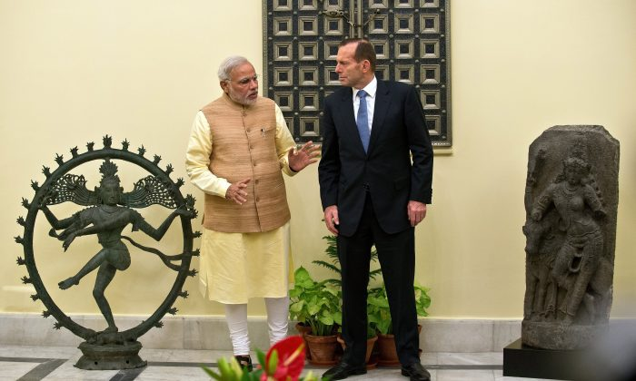 In September, Tony Abbott returned two antique statues to India in the presence of his Indian counterpart Narendra Modi. (Prakash Singh/AFP/Getty Images)