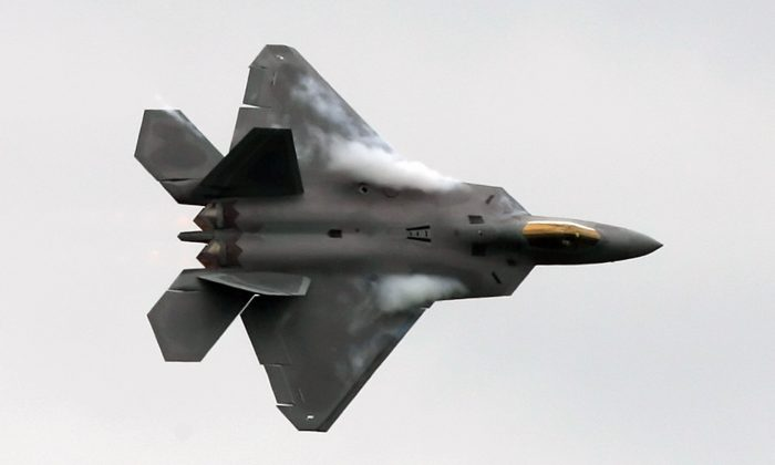 A US F-22 Raptor fighter flies during an aerial display at Farnborough Airshow, Hampshire on July 14, 2008.  A contingent of F-22s will join F-35s and other jets during a massive air exercise in South Korea Dec. 4 - 8, 2017. (CARL DE SOUZA/AFP/Getty Images)