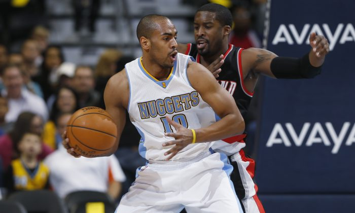 Denver Nuggets guard Arron Afflalo, front, tries to work the ball inside for a shot as Portland Trail Blazers guard Wesley Matthews covers in the first quarter of an NBA basketball game in Denver on Tuesday, Dec. 2, 2014. (AP Photo/David Zalubowski)