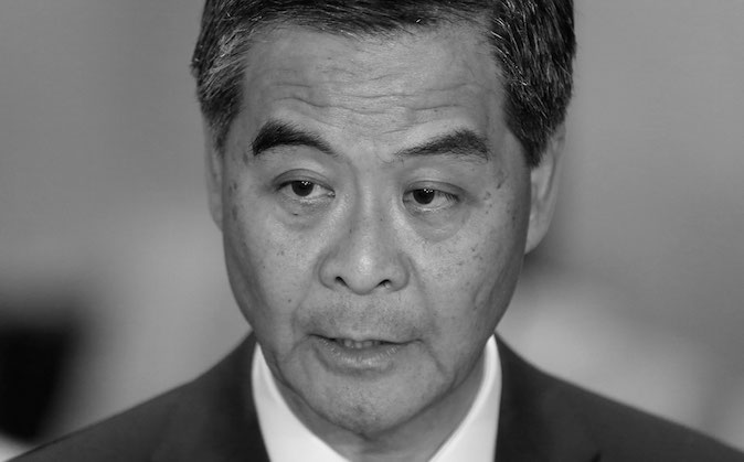 Hong Kong Chief Executive Leung Chun-ying speaks to the media after a presentation ceremony in Hong Kong on Wednesday, Oct. 15, 2014. (AP Photo/Kin Cheung)