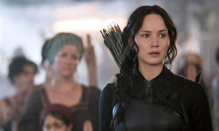 """Jennifer Lawrence portrays Katniss Everdeen in a scene from """"The Hunger Games: Mockingjay Part 1."""" (AP Photo/Lionsgate, Murray Close)"""