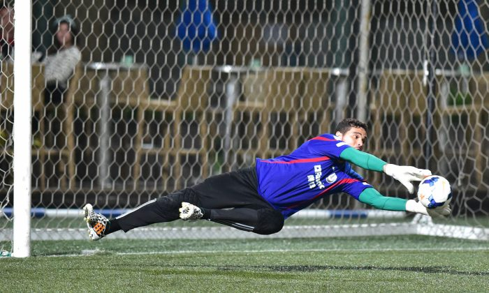 Citizen's goalkeeper saves against HKFC in their HKFA Division 1 match at Sports Road on Saturday Nov. 29, 2014. (Bill Cox/Epoch Times)