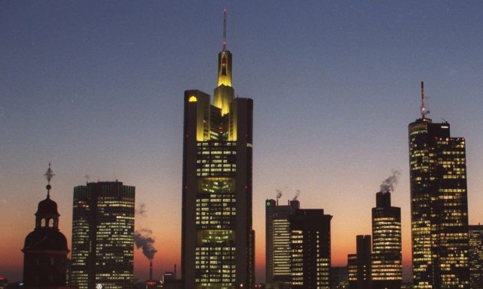 The banking district in downtown Frankfurt, Germany, with buildings from left: Church St. Catherine, European Central Bank, Commerzbank Headquarters, Dresdner Bank, Japan Tower, Citibank, Main Tower, on February 2000. On Dec. 2, 2014, the issue of looming deflation seems the main factor driving European policymakers when they meet later this week and forcing speculation that the ECB will switch on the printing press to help the economy by injecting new money into the economy. (AP Photo/Bernd Kammerer)