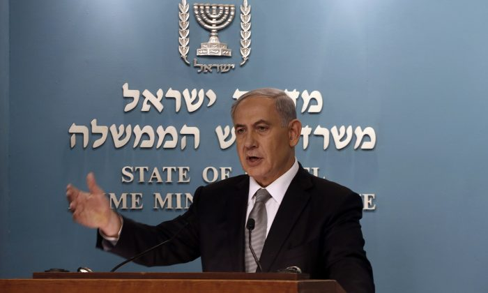 Israeli Prime Minister Benjamin Netanyahu gestures during a press conference in Jerusalem, Tuesday Dec. 2, 2014. Israel's prime minister fired two senior Cabinet ministers from his divided government Tuesday and said he would call early elections, plunging the country toward a heated campaign more than two years ahead of schedule. (AP Photo/Gali Tibbon)