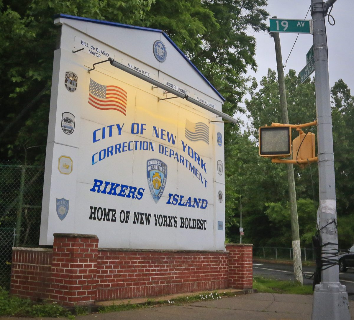 The main sign for the Rikers Island jail in the Queens borough of New York on June 11, 2014. New York Mayor Bill de Blasio plans to announce his $130 million, four-year plan to overhaul how the nation's most populous city deals with mentally ill and drug-addicted suspects, diverting many to treatment instead of jail. (AP Photo/Bebeto Matthews)