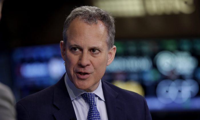 New York Attorney General Eric Schneiderman at the New York Stock Exchange in New York on Aug. 21, 2014. Schneiderman launched a new web-based app on Tuesday, Dec. 2, 2014 to help struggling homeowners determine whether offers of foreclosure rescue are legitimate or scams. (AP Photo/Richard Drew)