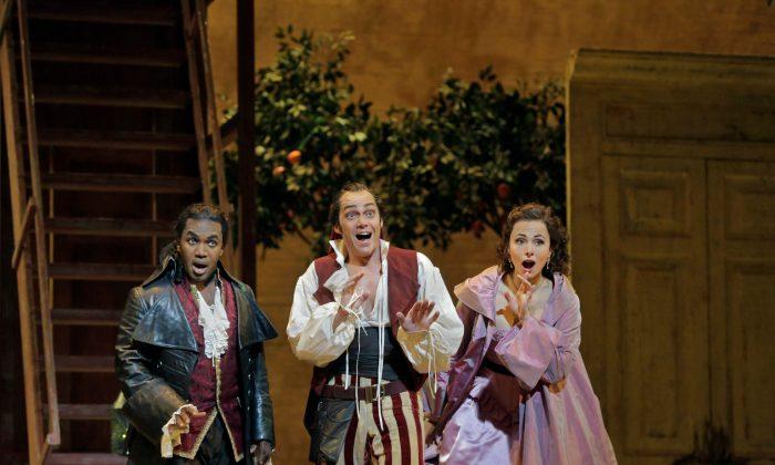 "The stars of the Metropolitan Opera's production ""The Barber of Seville,"" (L–R) Lawrence Brownlee as Count Almaviva, Christopher Maltman as Figaro, and Isabel Leonard as Rosina. (Ken Howard/Metropolitan Opera)"