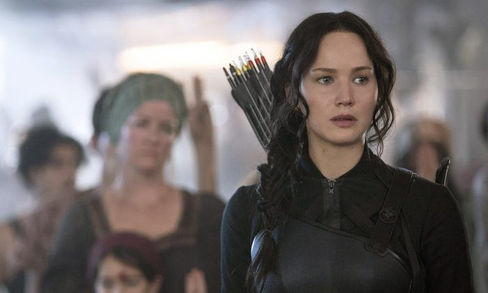 "Jennifer Lawrence portrays Katniss Everdeen in a scene from ""The Hunger Games: Mockingjay Part 1."" (AP Photo/Lionsgate, Murray Close)"