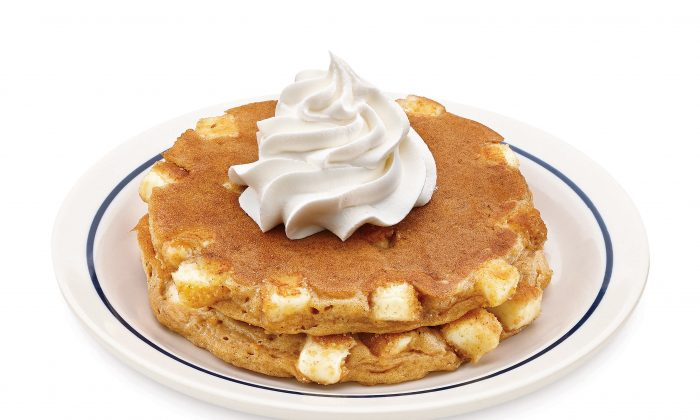 There's a number of chain restaurants open on New Year's Day. This undated product image provided by IHOP shows the restaurant chain's Pumpkin Cheesecake pancakes. IHOP is one of many businesses that roll out a number of limited-time flavors around the holidays. (AP Photo/IHOP)
