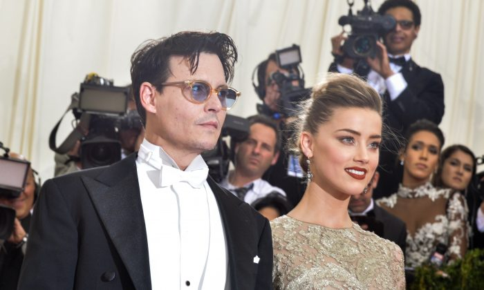 """Johnny Depp and Amber Heard attend the """"Charles James: Beyond Fashion"""" Costume Institute Gala at the Metropolitan Museum of Art on May 5, 2014 in New York City.  (Photo by Andrew H. Walker/Getty Images)"""
