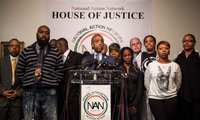 (L-R) Michael Brown Sr., father of Michael Brown Jr.; Benjamin Crump, lawyer for Michael Brown Jr's family; Reverand Al Sharpton; Kimberly Michelle Ballinger, Mother of Akai Kareem Gurley's daughter; Gwen Carr, Mother of Eric Garner; Lesley McSpadden, mother of Michael Brown Jr, and Emerald Garner, daughter of Eric Garner attend a press conference on the eve of Thanksgiving to pray and address the events of the last few days regarding the grand jury verdict of police officer Darren Wilson on Nov. 26, 2014, in New York City. Police officer Darren Wilson shot 18-year-old Michael Brown in Ferguson, Mo., on Aug. 9, sparking large ongoing protests. (Andrew Burton/Getty Images)