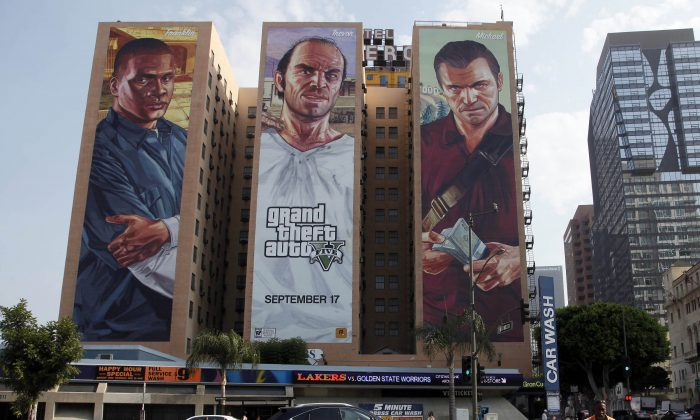 """Grand Theft Auto: San Andreas 2 is not being made by Rockstar and it won't be coming out in the summer of 2015. FILE - This Sept. 10, 2013 file photo shows the """"Grand Theft Auto V """" billboard at Figueroa Hotel in Los Angeles. Target Australia said Wednesday, Dec. 3, 2014, it is removing """"Grand Theft Auto V"""" from store shelves after an online petition signed by more than 40,000 individuals asked the retailer to stop selling the video game because they said it encourages players to murder women for entertainment.  (AP Photo/Nick Ut, File)"""