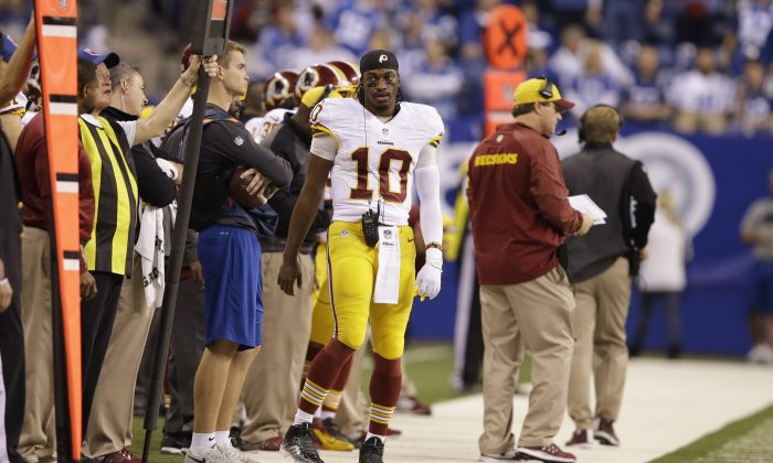 Washington Redskins quarterback Robert Griffin III on the sideline during the second half of an NFL football game against the Indianapolis Colts Sunday, Nov. 30, 2014, in Indianapolis. (AP Photo/Darron Cummings)
