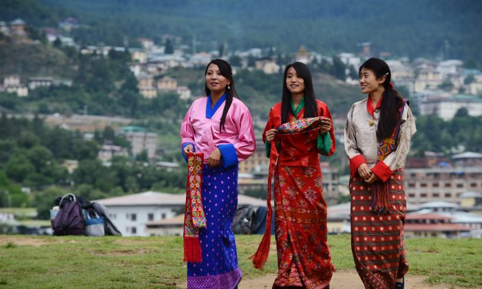 Schoolgirls wear traditional dresses before a cultural event to celebrate the birth date of Bhutan's fourth king at a local school in Thimphu, Bhutan, on June 2, 2013. (Roberto Schmidt/AFP/Getty Images)