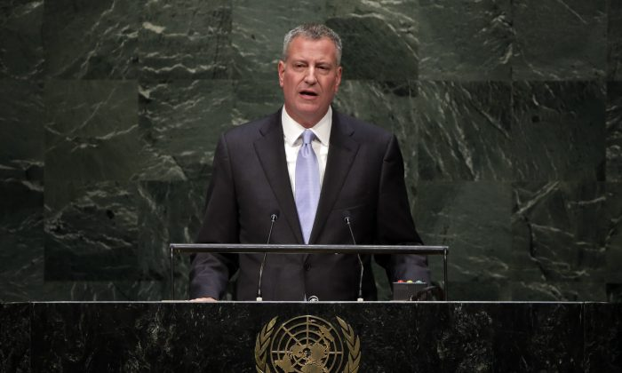 New York Mayor Bill de Blasio addresses the Climate Change Summit, at United Nations headquarters on Tuesday, Sept. 23, 2014. De Blasio on Wednesday will create a new agency, the Office of Sustainability, and name Clinton White House veteran Nilda Mesa its first director, administration officials told The Associated Press. (AP Photo/Richard Drew)