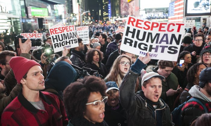 About 400 protesters gathered on Times Square, Manhattan, NY, on Dec. 3, 2014, to protest Staten Island Grad Jury decision that a police officer who used chokehold on Eric Garner will not be indicted for Garner's death. (Petr Svab/Epoch Times)